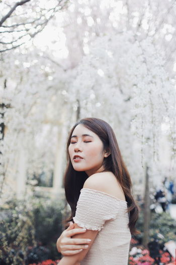 My Best Photo International Women's Day 2019 Streetwise Photography Tree Young Adult One Person Young Women Plant Long Hair Hairstyle Lifestyles Leisure Activity Standing Focus On Foreground Hair Real People Women Day Beautiful Woman Adult Nature Side View Contemplation Outdoors Springtime Cherry Blossom