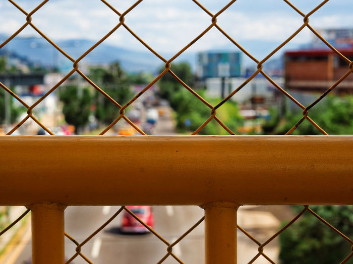 Crossing the bridge Bridge Chainlink Fence Close-up Day Focus On Foreground Highway Mexico Nature No People Outdoors Protection Road Safety Security Sky Traffic Travel Photography Adapted To The City