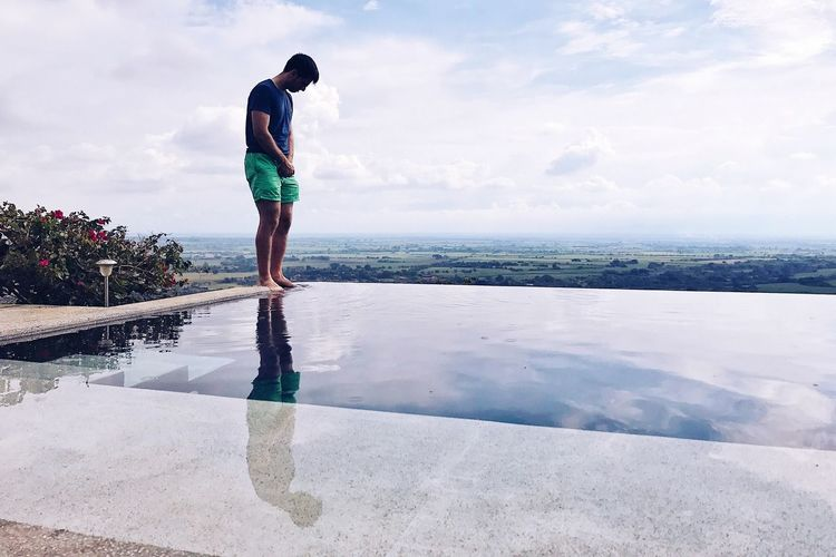 Mirror, mirror, on the floor. Water Full Length Rear View One Person Real People Sky Standing Reflection Scenics Pensive Reflections Reflecting Pool Infinite Pool Lost In The Landscape Mind  Posibillities Thinking Capture Tomorrow