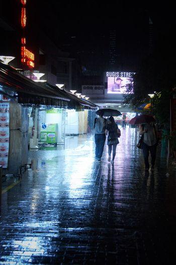 Let Me Walk You Home Silhouette Couple City Illuminated Night Building Exterior Architecture Wet Street Rain City Life Water Walking Umbrella Women Lifestyles Men