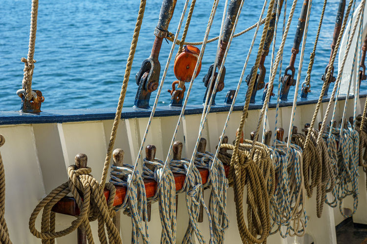 Rope tied to moored at harbor