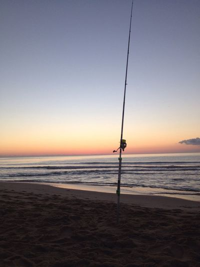 Sea Water Horizon Over Water Sunset Beach Sky Nature Outdoors Scenics Weekend Activities Tranquility Beauty In Nature One Person Men Fishing Pole Day Sardegna Abamar