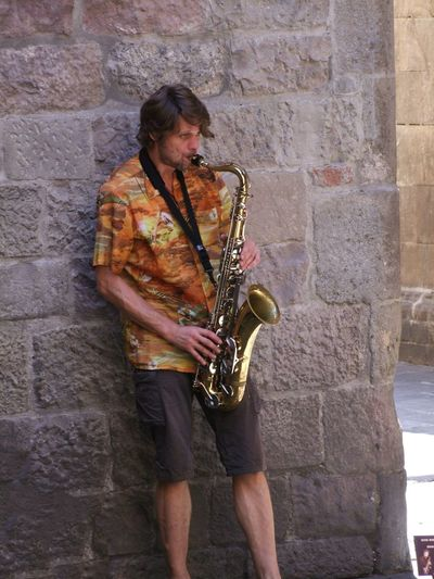 Saxophonist Busking, Carrer Montcada Barcelona Busker Casual Clothing City Life Composition Full Frame Full Length Fun Happy Musician No Incidental People Outdoor Photography Person Saxophone Saxophonist Spaın Standing Stone Wall Tourism Tourist Destination Young Adult Young Man
