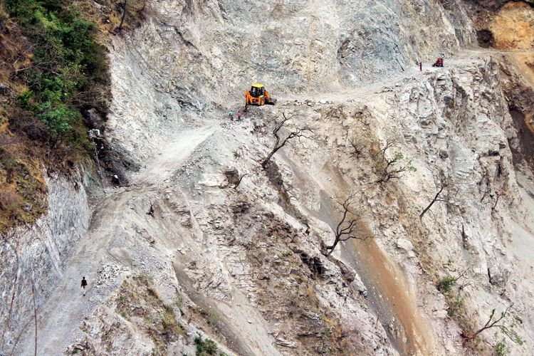 High angle view of earth mover on rock