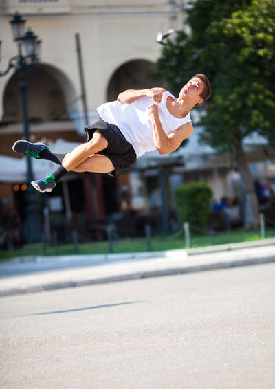 Acrobat Acrobatic Caucasian City Exercise Extreme Men Outdoor Park Physical Somersault  Spin Sport Sportsman Street Teenager Tumbleset Vertical Youth