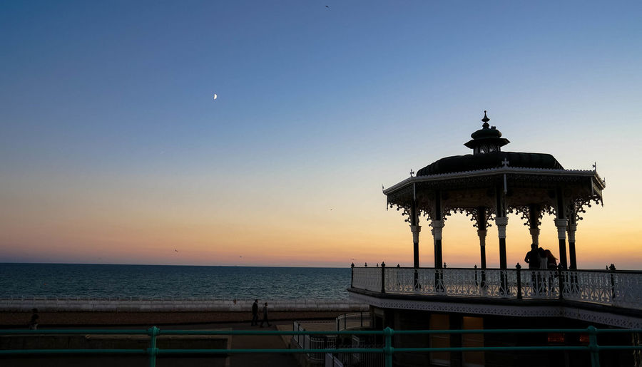 Bandstand Bright Brighton Bandstand Architectural Column Architecture Beach Built Structure England Horizon Over Water Moon Outdoors Scenics - Nature Sea Side Sea Side Town Silhouette Sky Sunset Water
