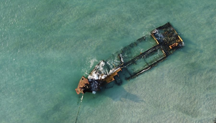 Aerial view of shipwreck in sea