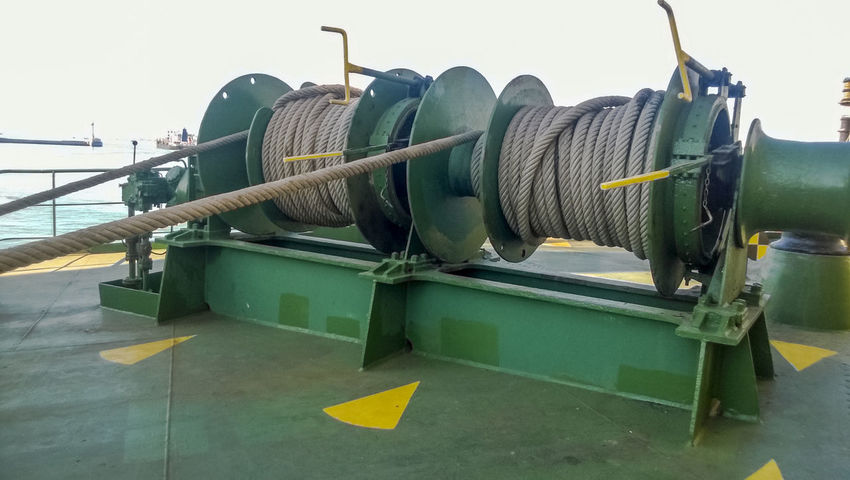 Mechanisms of tension control ropes. Winches. Equipment on the deck of a cargo ship or port Clear Sky Close-up Control Day Green Color Mechanisms Nautical Vessel No People Outdoors Ropes Ship Sky Tension Transportation Yellow