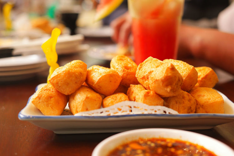 Close-up of fried toufu on table