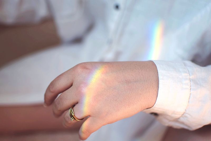 Catching light. Light Reflection Pride Rainbow Hand Human Hand Human Body Part Jewelry One Person Close-up Indoors  Focus On Foreground Ring Adult Finger Lifestyles This Is My Skin The Still Life Photographer - 2018 EyeEm Awards 2018 In One Photograph