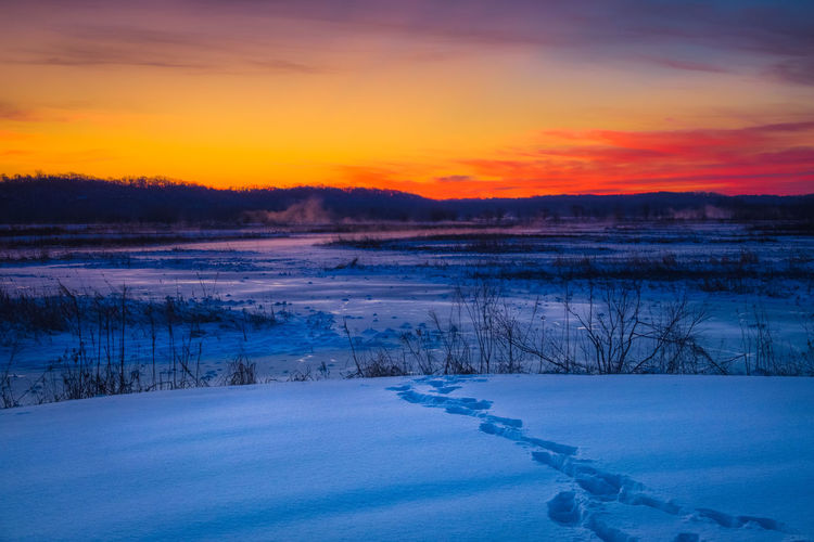 Winter Cold Temperature Snow Tranquil Scene Tranquility Sunset Scenics - Nature Sky Beauty In Nature Environment Landscape Frozen Nature No People Non-urban Scene Lake Water Ice Orange Color Outdoors Cold Frozen Water