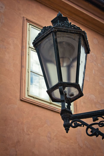 Lighting Equipment Built Structure Architecture Low Angle View Electric Lamp No People Building Exterior Street Light Day Mounted Lantern Wall - Building Feature Window Metal Wall Retro Styled Electric Light Outdoors Light Antique Light Fixture Streetphotography Street Photography Street Prague