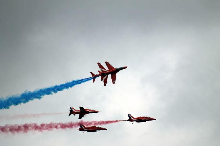 Aerial Acrobatic Of Red Arrows Performing As Team