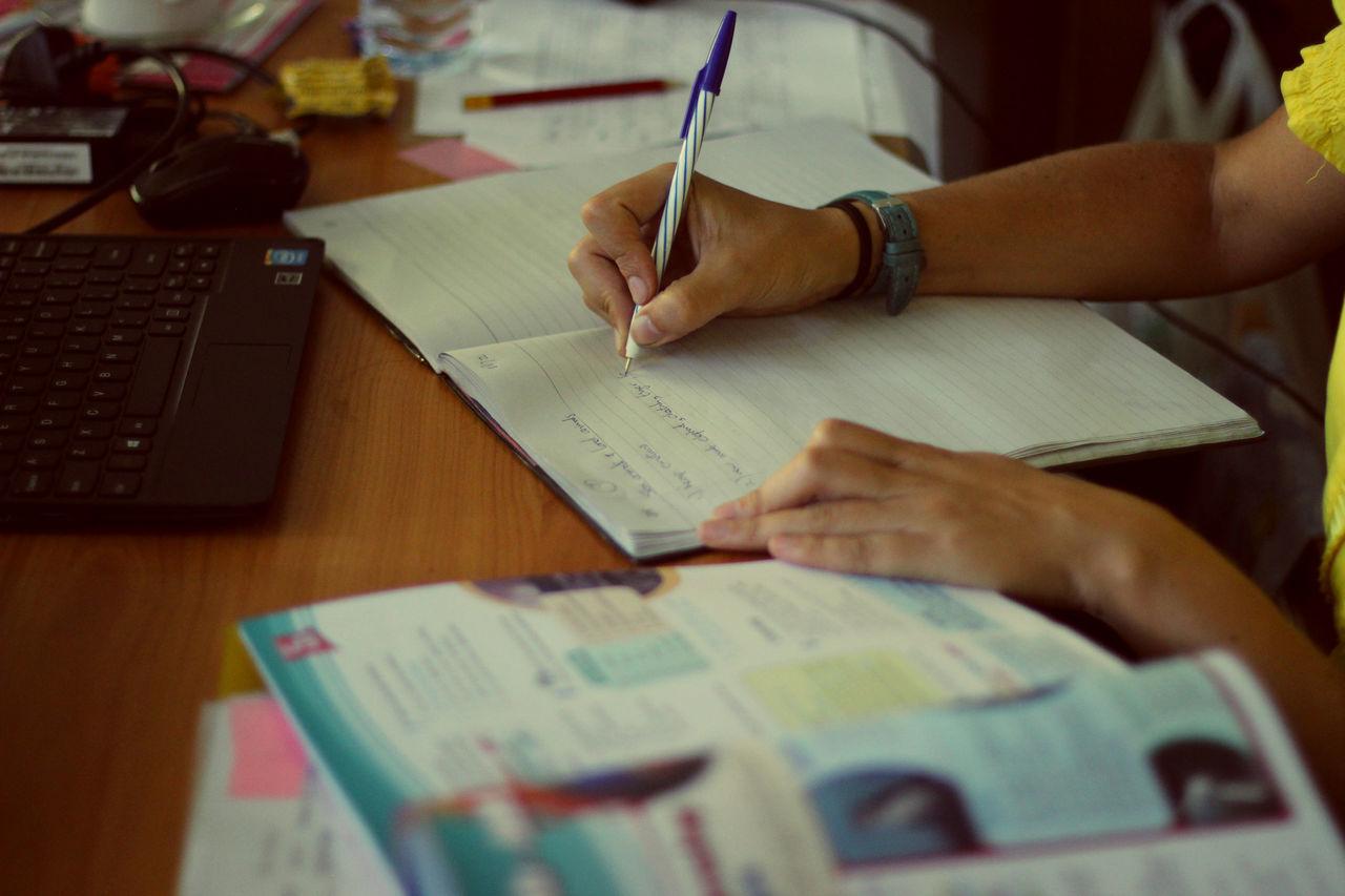 Girl (10-11) writing homework