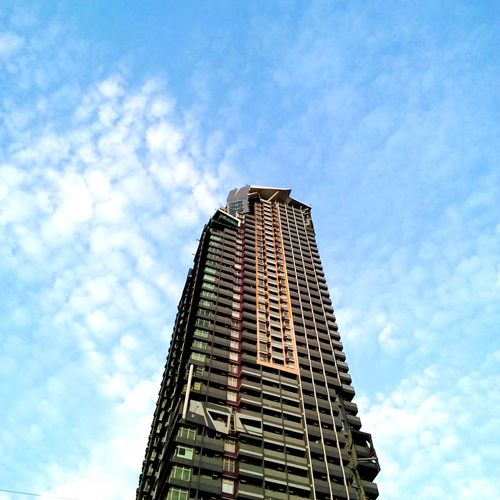 Edifice. Low Angle View Architecture Modern Skyscraper Built Structure Sky Day Building Exterior No People Outdoors Building Philippines EyeEmPhilppines Eyem Market Eyeemphotography Eyeem Philippines Eyeemarket Eyem Philippines Eyeemphoto Eyeem Photography Eyeemmarket