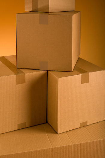 Boxes in an empty room representing concept of home moving Box - Container Brown Business Cardboard Cardboard Box Container Distribution Warehouse Empty Freight Transportation Moving House Moving Office Packing Shipping  Stack Transportation