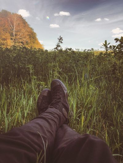 Low section of man relaxing on field