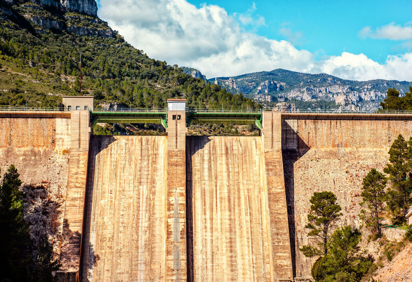 View of the Ulldecona reservoir. Valencian Community, Spain Architecture Cloud - Sky Construction Day Europe Gravity Landscape Mediterranean  Mountain Nature No People Nobody Outdoors Reservoir Reservoir Dam River Sky SPAIN Sunny Day Ulldecona Wall Water Storage Dam
