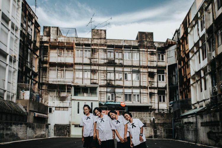 Architecture Building Exterior Group Of People Built Structure Young Men Men City Day Togetherness Young Adult Sky Real People Adult Women Building Standing Outdoors People Nature