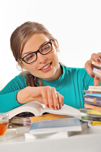 a student girl studying at library Beautiful People Beauty Cheerful Child Cute Desk Education Elementary School Elementary Student Eyeglasses  Girls Happiness Homework Indoors  Intelligence Learning People Portrait Research School Building School Children SchoolGirl Smiling Student Writing