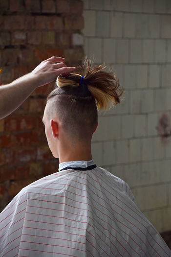 Hipster's hairstylist making haircut in barber shoop Barber Barbershop Brick Wall Close-up Day Hair Haircut Time Hairstyle Hairstylist Headshot Hipster Hipster - Person Hipster Style Leisure Activity Lifestyles Making Men One Person People Real People Modern Workplace Culture