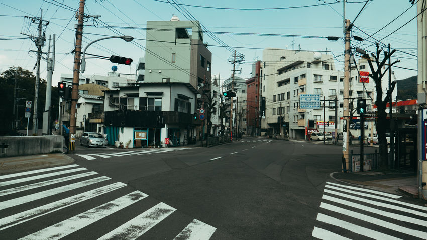 Architecture Building Exterior Built Structure Cable City City Life City Street Day Electricity Pylon Japan Japan Photography No People Outdoors Power Line  Road Street Transportation