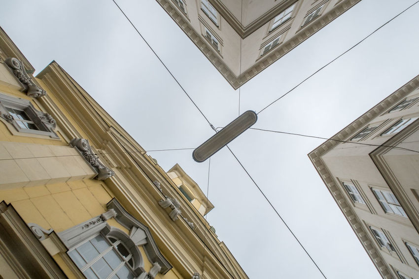 Looking up a building Light Architecture Building Exterior Built Structure City Day Lamp Lines And Shapes Lookingup Lookingupatbuildings Low Angle View No People Outdoors Sky