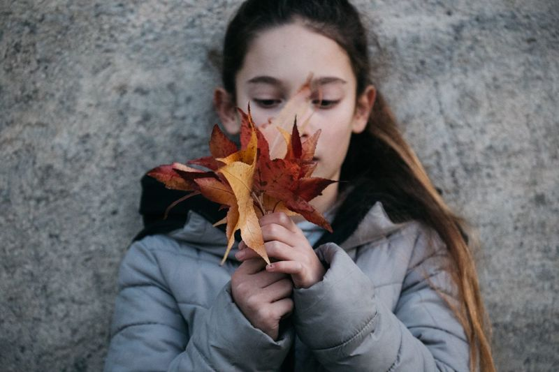 Autumn Leaf One Person Change Holding Front View Maple Leaf High Angle View Headshot Real People Leisure Activity Lifestyles Young Women Outdoors Day Women Close-up Young Adult Nature Maple EyeEmNewHere The Week On EyeEm Autumn Mood International Women's Day 2019