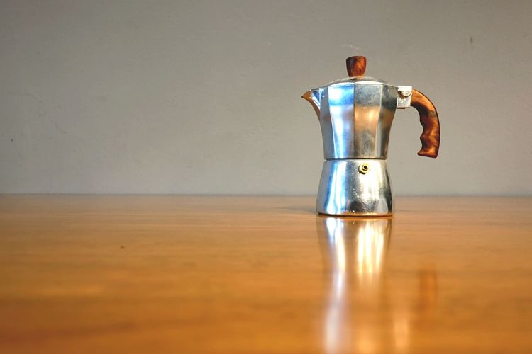 Indoors  Reflection Table Single Object No People Coffee Coffee Break Coffee Maker Moka Pot Espresso Style Copy Space Decoration Kitchen Utensils Metal Home Drink Close-up