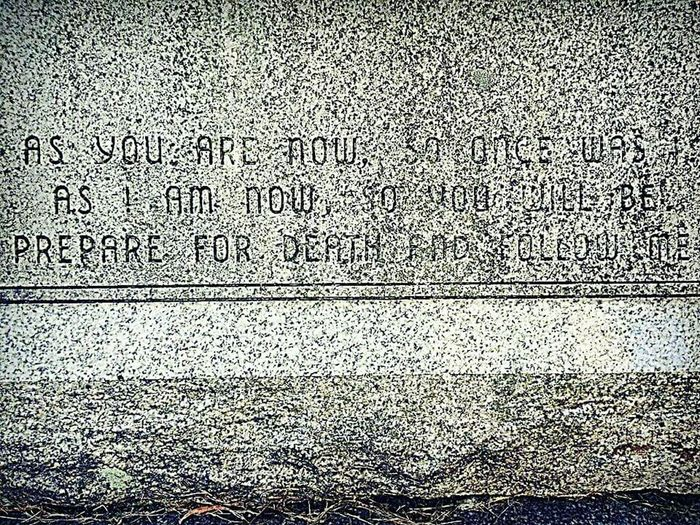 On a tombstone. This chap had a morbid streak. I dig it. Morbid Death Is Chasing Us All