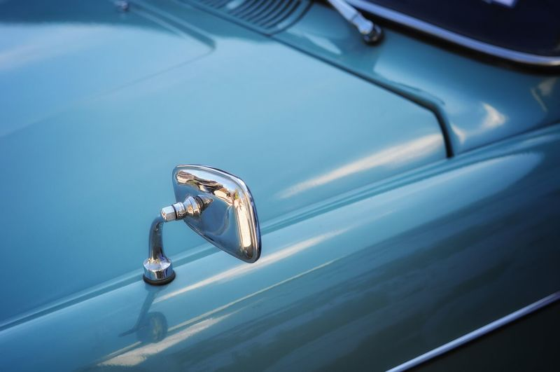 Close-up of mirror on car