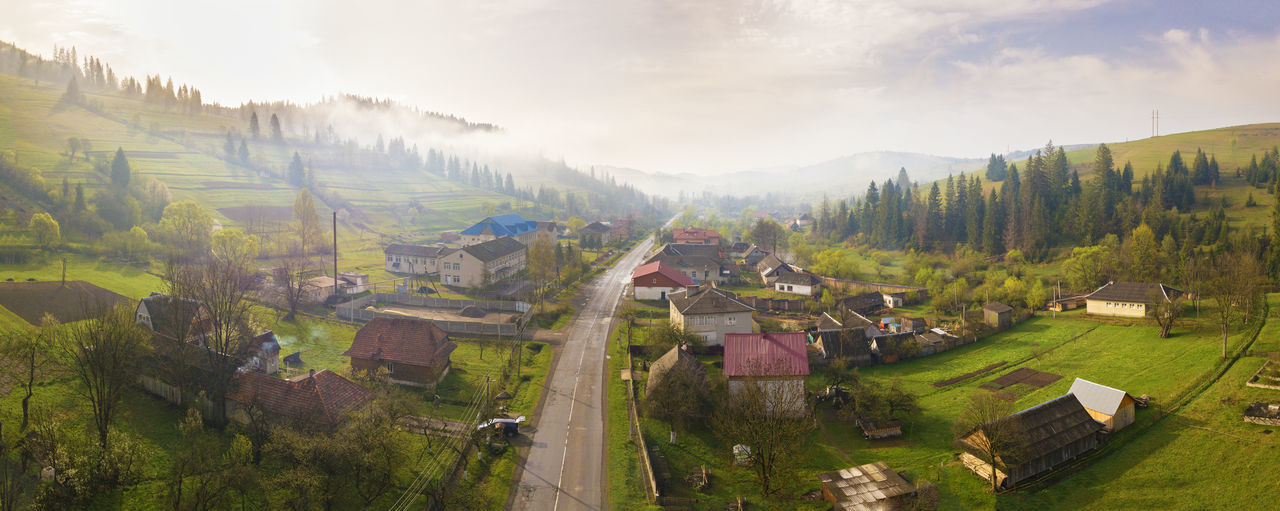 Architecture Scenics - Nature Landscape Environment Nature Building Land Sky House Field Panoramic Building Exterior Built Structure Rural Scene Cloud - Sky High Angle View Residential District Day Fog Plant No People Outdoors Spring Road Travel Trip