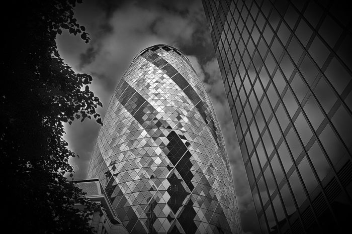 30 St Mary Axe aka The Gherkin in London by architect Norman Foster Architecture Building Building Exterior Built Structure City Cloud - Sky Cloudy Day Glass - Material Low Angle View Modern No People Office Building Outdoors Reflection Sky Skyscraper Tall - High Tower Travel Destinations