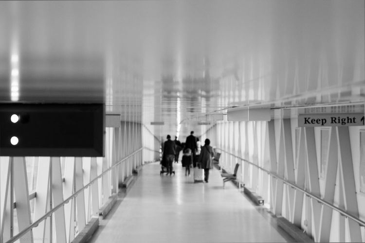 People walking in passage of stansted airport