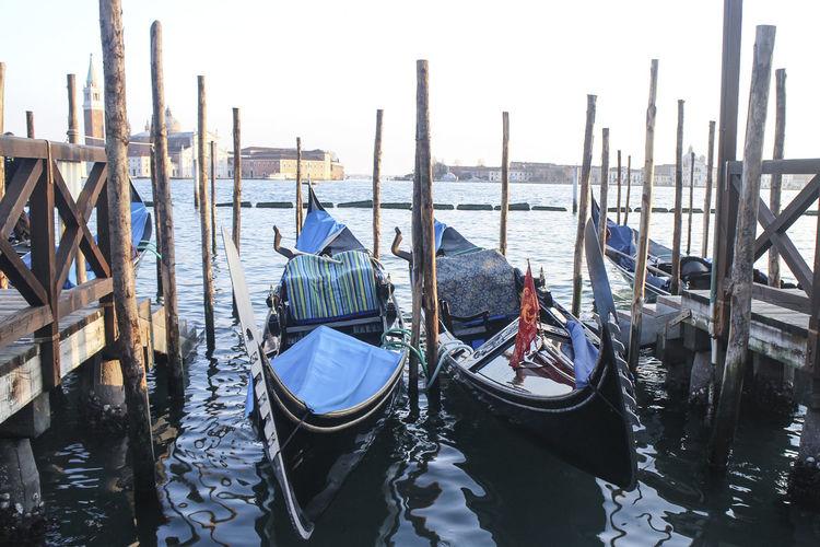 Gondola boat moored on grand canal against san giorgio maggio church