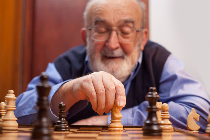 old man playing chess Man Retired Caucasian Checkmate Chess Chess Board Chess Piece Competitive Eyeglasses  Front View Game Hand Holding Indoors  Intelligence Leisure Games Lifestyles Match Pensioner Playing Senior Men Skill  Strategy Table Wisdom