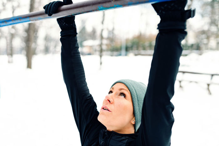 Female Athlete Exercising In Park In Winter With Snow Around The Park Athlete Exercise Horizontal Lifestyle Nature Running Winter Active Black Cold Female Fit Fitness Jogging Outdoors Outside Park Pull Ups Runner Snow Training White Workout