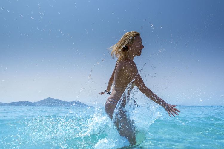 A girl jumping into water after that there is a huge splash and a lot of drops of water. Frozen in a moment. I captured the moment. Adventure Beauty In Nature Blue Wave Drop Drops Of Water Fun Girl Greece Island Lifestyles Motion Nature Naxos Ocean Outdoors Sea Sharp Splash Splashing Summer Tourism Vacations Water Waterfront Woman Neighborhood Map Live For The Story