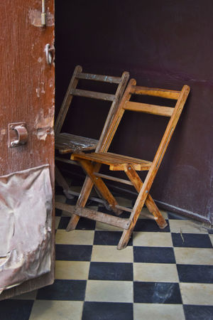 Home entrance off the street in a small town in the Yucatan of Mexico Brown Chair Checked Pattern Day Door Entrance Flooring Furniture High Angle View Indoors  No People Pattern Seat Still Life Tile Tiled Floor Wood - Material Yucatan, Mexico, Home, Door