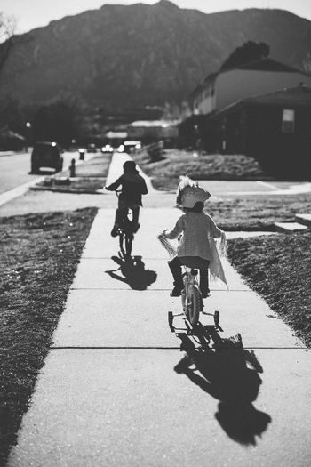 Biking siblings. Full Length Real People Two People Day Outdoors Lifestyles Togetherness Mountain Leisure Activity Bonding Road Childhood People Adventure Headwear Friendship Helmet Tree Siblings Welcome To Black