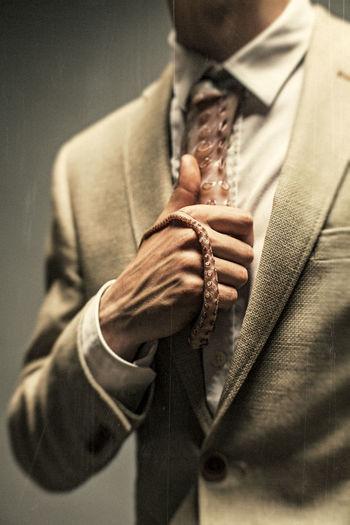 can you help me with tie? EyeEm Best Shots The Week on EyeEm Close-up Human Hand Jacket Men Necktie Suit Tentacle EyeEmNewHere The Creative - 2018 EyeEm Awards