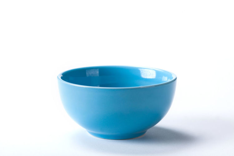 Close up Ceramic blue bowl isolated on white background shoot in the studio with space for copy. Bowl Isolated White Food Background Dish Empty Object Dishware Plate Clean Round Tableware Meal Nobody Kitchenware Utensil Top Circle Kitchen Lunch Restaurant Container View Closeup Healthy Cooking Table Ceramic Soup Blank Porcelain  Breakfast Single Dinner Dining Shiny Pot Delicious Eating Diet Serving Deep New Close-up Studio Pottery Menu Idea Blue
