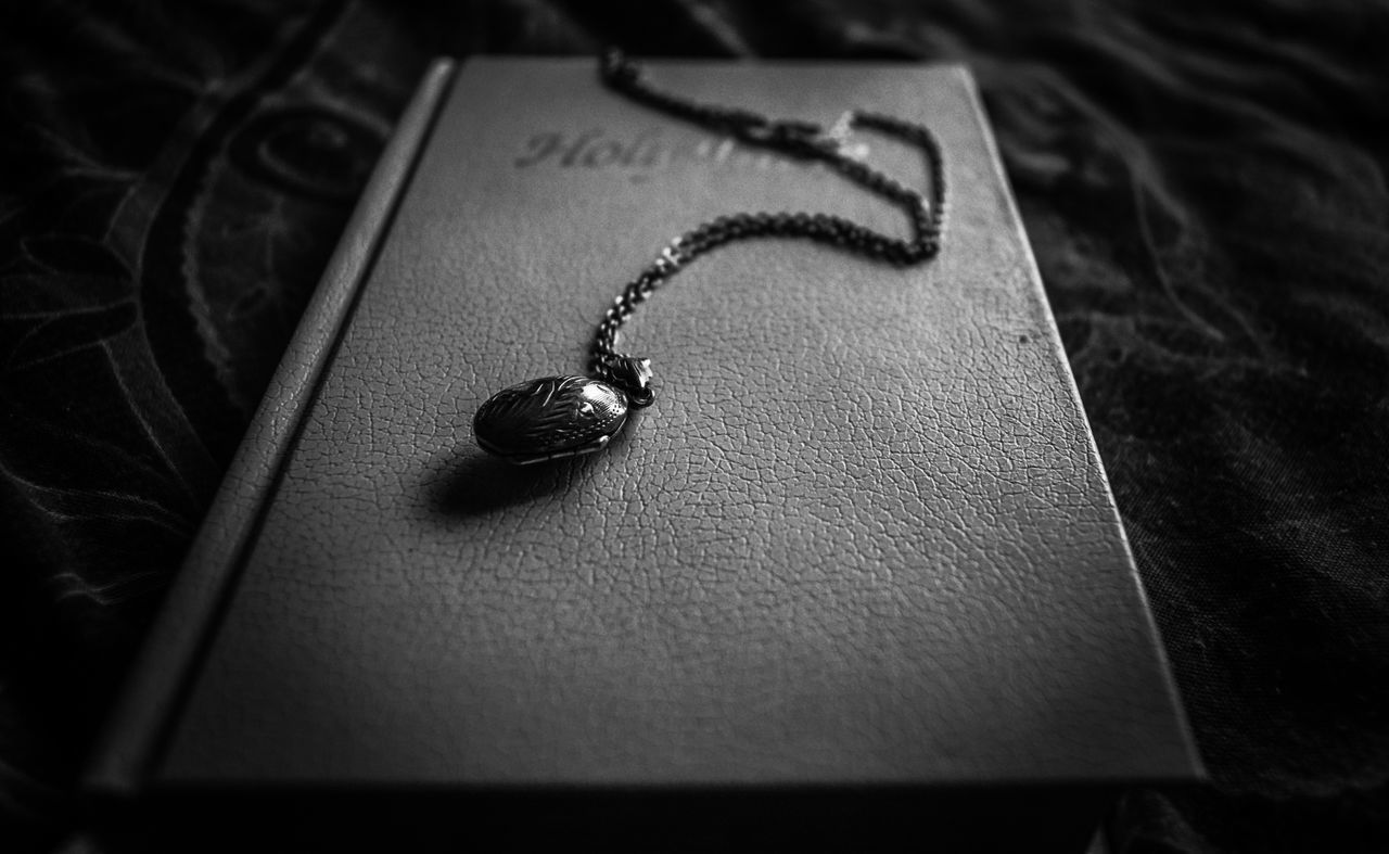 still life, jewelry, close-up, indoors, no people, necklace, locket, day