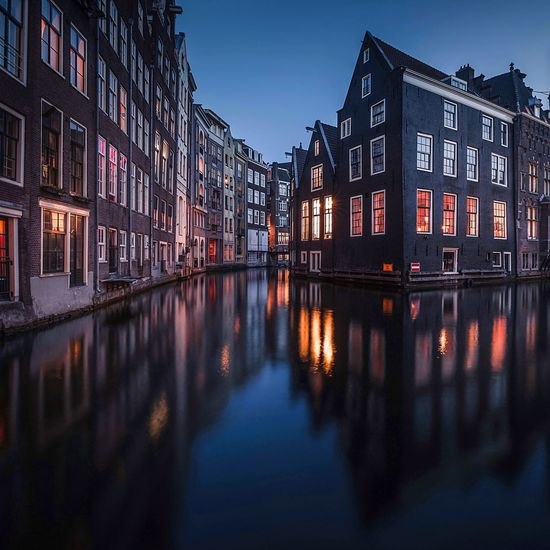 City of unique Building Exterior Architecture Built Structure Water Reflection City Illuminated Building Sky Night Nature Dusk Residential District No People Waterfront Transportation Street River Travel Outdoors
