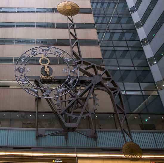 Low angle view of clock on modern building