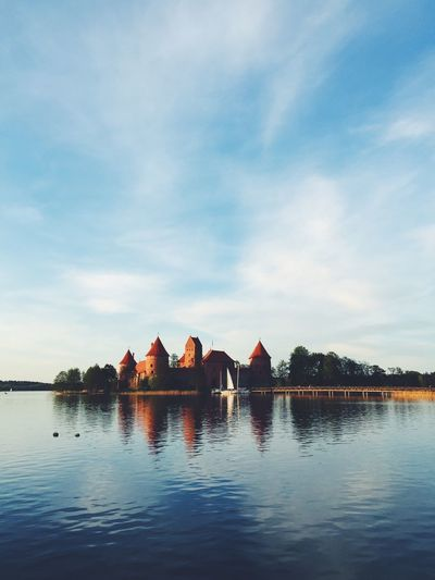 Trakai island castle by lake galve against sky