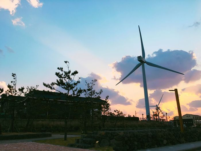 Battle Of The Cities Sunset Sky Tree Environmental Conservation Cloud Alternative Energy Outdoors Rural Scene Renewable Energy Cloud - Sky Solitude Windmill Tranquil Scene Nature Mountain Scenics No People Tranquility Bright Remote