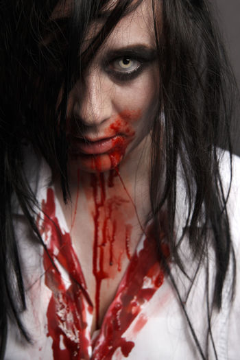 Portrait Of Woman In Halloween Make-Up Against Black Background