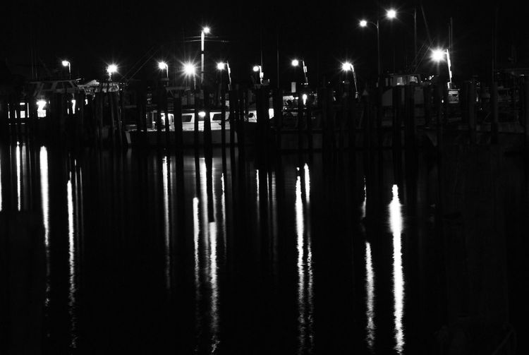 Night shot in B&W of marina lights reflecting in the inky black water. EyeEm New Here EyeEm New Jersey EyeEm Black&white! EyeEm Nature Lover Fishing Summertime Beach Reflections South Jersey Nj Photography Njspots Nj Delaware Bay Fortescue New Jersey Boating Nighttime Nite Night Photography Night Night Illuminated Reflection Water Lighting Equipment Street Light Transportation Waterfront No People Nature Light - Natural Phenomenon