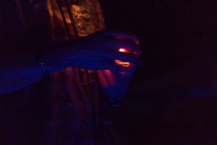 Blue Hands, OR Blue Close-up Dark Festival Of Lights Festival Season Glow Hands Healing Human Body Part Human Hand Illuminated Indoors  Lifestyles Love Nail Polish Night One Person Orange People People Watching Prayer Real People Spirituality Standing Women